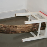 """detail of """"Theories on Wooden Behaviour"""", tree trunk with two stools, length 220 cm, 2008"""